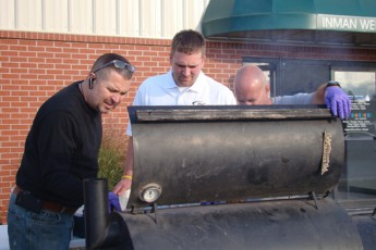 Kevin, Lucas, and Thayne keep an eye on the burgers and hot dogs at tailgate party, October 22, 2010.